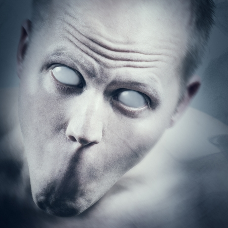 wierd: Psychedelic and scary man with white eyes and no mouth