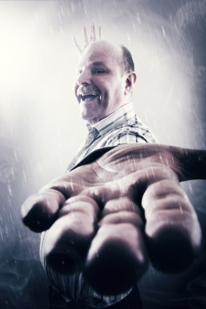 wierd: Wierd and strange guy with mustache in smoke and snow  Holding his hand out  Stock Photo