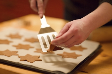 Girl baking ginger bread for Christmas  Natural Colors  Real life  photo