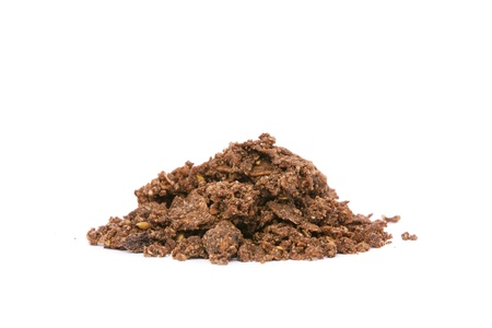 maca root: Side view of a pile of organic cacao crunchy cereal on white background  Superfood