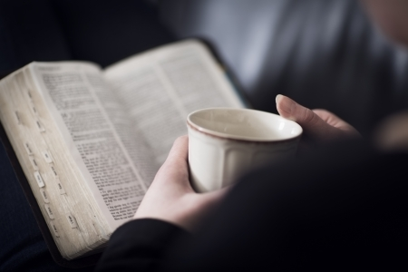 A close-up of a christian woman reading and study in the bible  Very shallow depth of fields  Toned  Stock Photo
