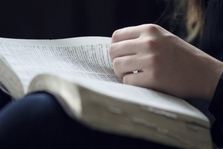 A close-up of a christian woman reading the bible  Very shallow depth of fields  photo