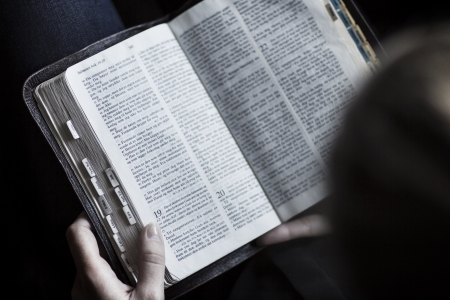 A close-up of a woman reading the bible  Very shallow depth of fields  photo