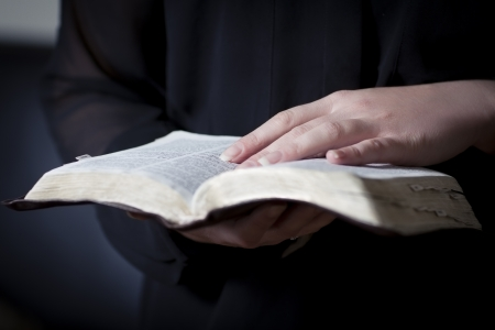 holding bible: A close-up of a christian woman reading the bible  Very shallow depth of fields