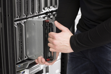server side: IT technician   engineer install   removes   replace a blade server in a data center  Stock Photo