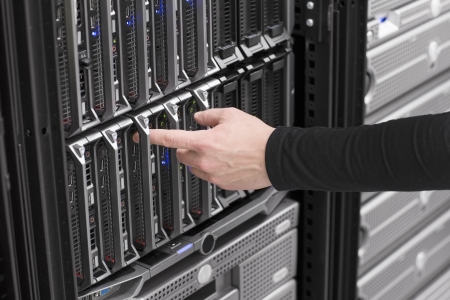 it technician: IT technician   engineer power on and install   removes   replace a blade server in a data center