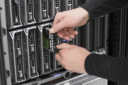 data center: It engineer   technician working in a data center  Replace a local hard drive in a blade serevr