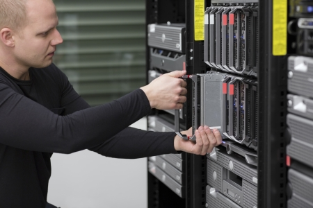 IT technician   engineer install   removes   replace a blade server in a data center  photo
