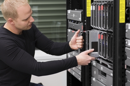 data backup: IT technician   engineer install   removes   replace a blade server in a data center  Stock Photo