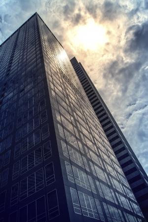 Modern office buildings skyscraper in sunlight Toned image