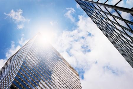 sky scrapers: Modern office buildings   skyscrapers in sunlight  Blue toned image