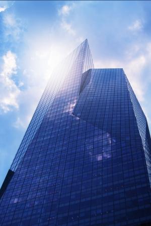 sky scrapers: Modern office building  skyscraper  in sunlight Toned image