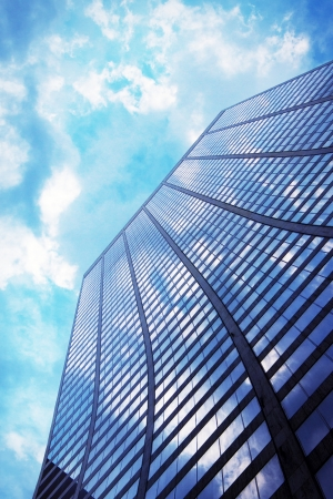sky scrapers: Glass office buildings   skyscrapers in sunlight Blue toned image  Stock Photo