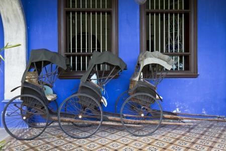 malaysia culture: Cheong Fatt Tze s Blue Mansion in Georgetown, Penang, Malaysia  Photo of three Tuk-Tuk s