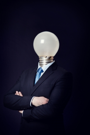 bad idea: Business consept with a man with a lighting bulb as head  Bright or bad idea  Stock Photo
