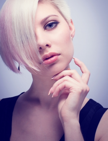 A beautiful and Glamorous young woman with creative hair style  Toned and natural retouched  photo