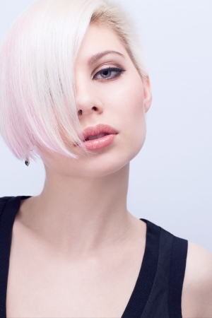 A beautiful and blond scandinavian young woman with creative hair style  Toned and natural retouched  photo