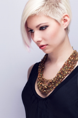 A beautiful and glamorous young woman with creative hair style  Colored and natural retouched  photo