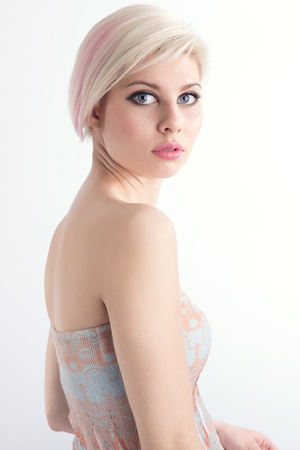 retouched: A beautiful and glamorous young woman with creative hair style  Colored and natural retouched