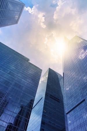sky scrapers: Modern office buildings  skyscraper  in sunlight  Toned image