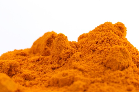 curcumin: Organic and raw curcumin   turmeric spice pile on white background  Can be used as a background