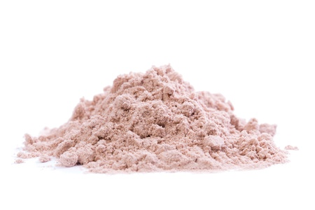 A heap of chocolate protein powder on white background  Sweeted with stevia  Stock Photo