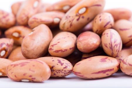 pinto: Raw Organic cranberry bean on white background