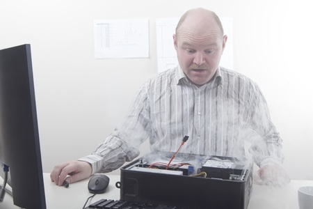 only men: Office worker   businessman with computer problems  Smoke  Stock Photo