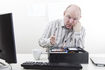 Office worker businessman with lose computer cables