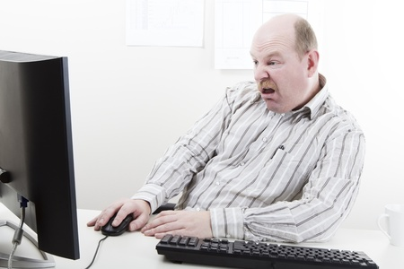 office physical pressure paper: Overworked office worker at his office desk  To much work