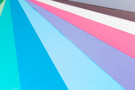 Pastel and vibrant colored paper in a pattern  photo