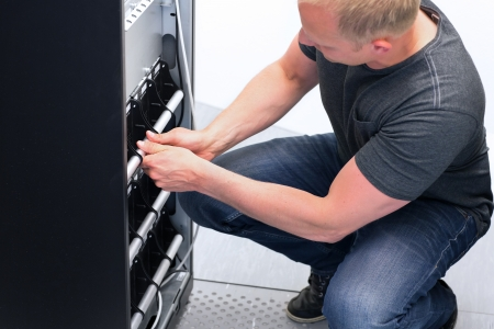 ups: IT Engineer  Consultant replace a large UPS   Uninterrupted Power Supply in a datacenter  Service on UPS  Stock Photo