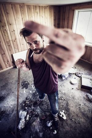 redneck: A young man and redneck   punk rocker gives finger