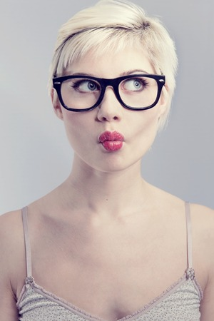 nerdy: Nerdy and thinking girl with horned glasses  Naturally toned