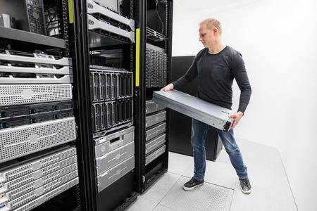 server side: It engineer or consultant rack server. Shot in data center. Stock Photo