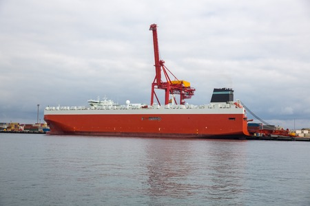 Cargo ship load or unload containers. International shipping industry. photo