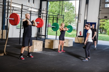 A group trains at a cross fit center  Weight workout at the gym