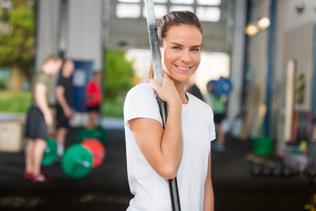 Attractive and smiling woman at crossfit center photo