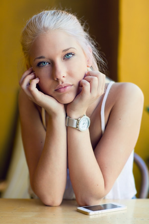 Thoughtful teenage girl with beautiful blue eyes photo