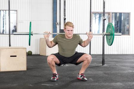 jerk: Squats training at fitness gym center