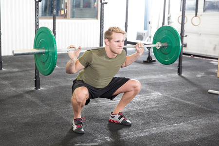Squat workout at fitness gym center photo