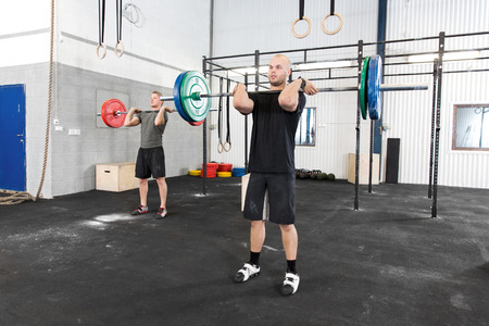 jerk: Clean and jerk workout at fitness gym center