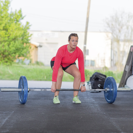 Fitness woman trains deadlift at the gym