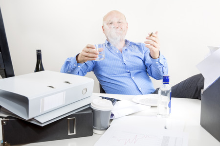 Drunk businessman smokes and drink at office photo