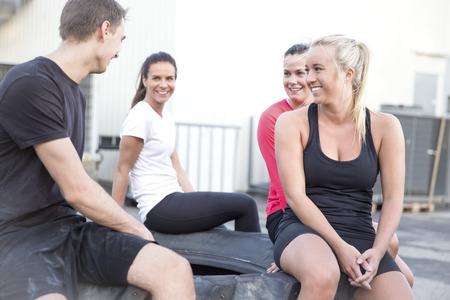 taking a break: Happy workout team taking a break outdoor