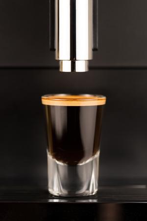 Espresso shot from exclusive coffee machine photo