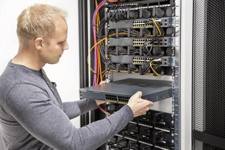 IT consultant build network racks in datacenter Foto de archivo