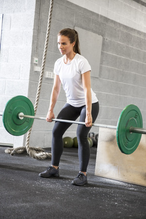 exercise weight: Woman lifts deadlift at the fitness gym