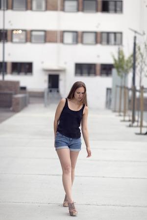 doped: Urban nordic fashion woman model walks in the city