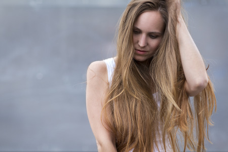 long depression: Woman model with long hair outdoor